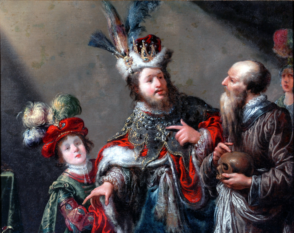 Image showing a painting of a man wearing an enormous crown with feathers pointing at something atoutside the frame and towards the bottom . He is flanked by a young boy, also wearing a flamboyant hat, and an old balding man with a beard