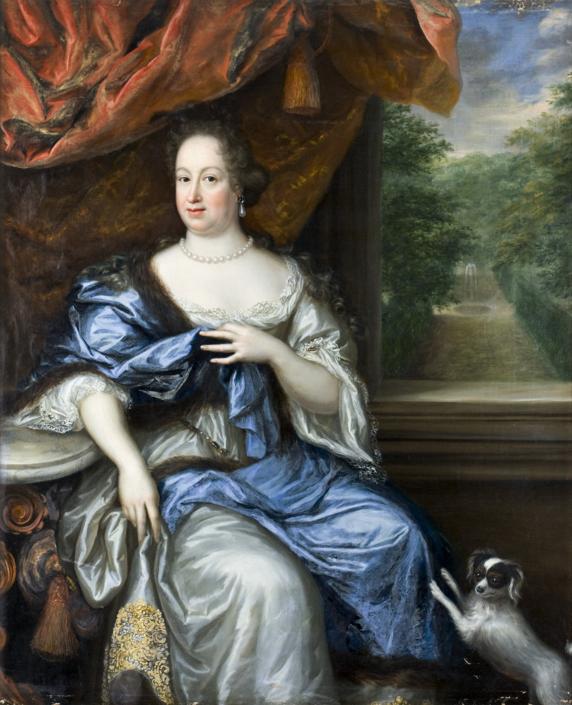 Portrait of a woman wearing a sumptuous blue and white dress. A lap dog stands on his back legs, his front paws resting on her legs as he looks to the left of the frame